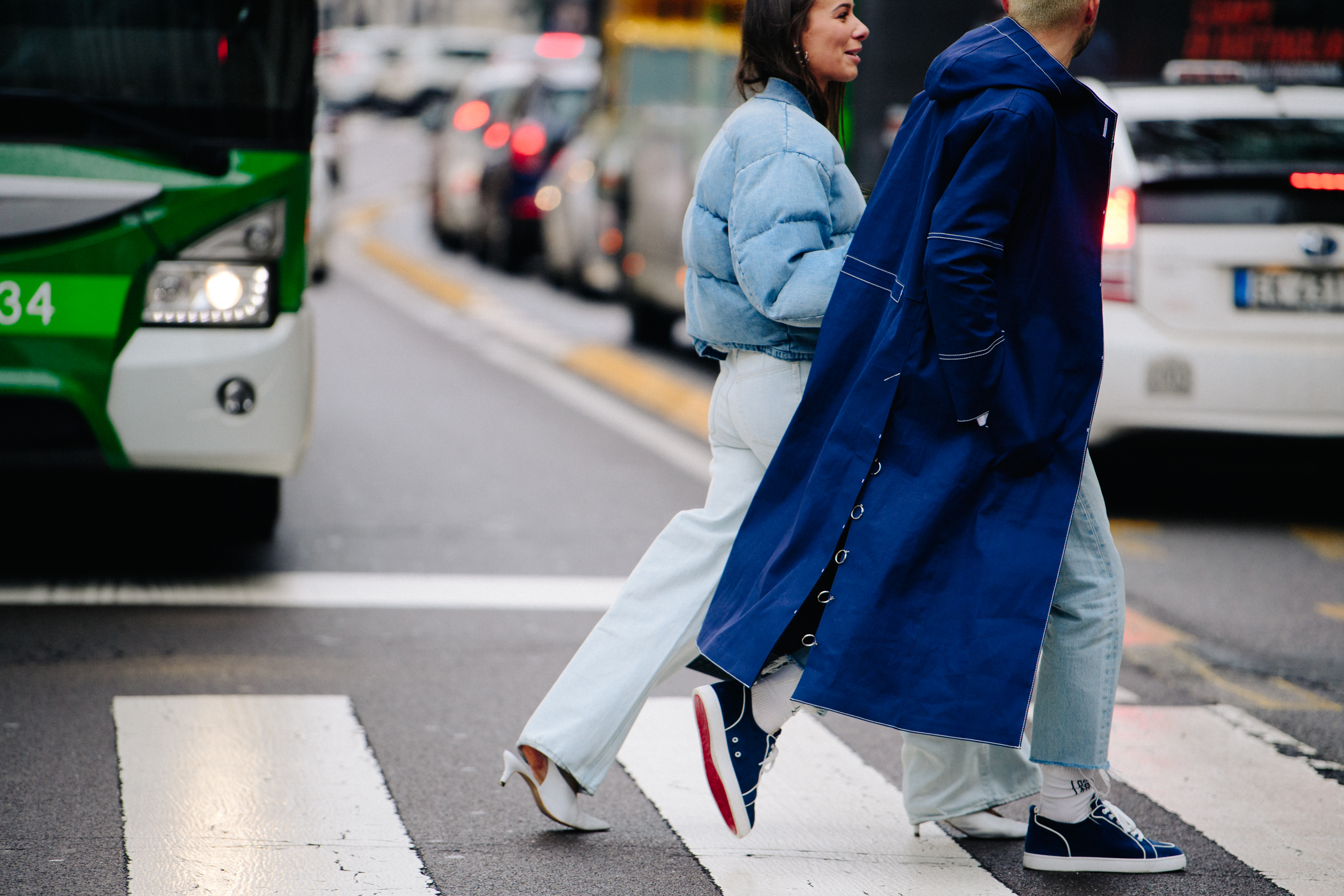 Couple wearing blue outfits